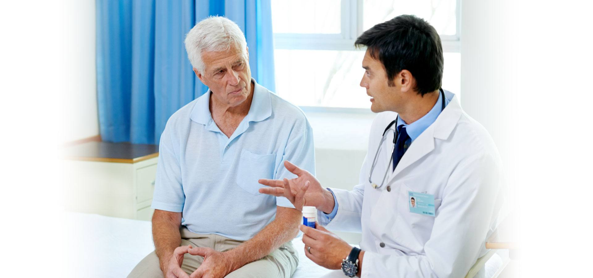 doctor speaking to elderly male patient